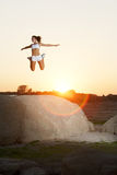 A woman jumps for joy Royalty Free Stock Photos
