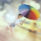 Woman jumps over light glitter background Royalty Free Stock Photography