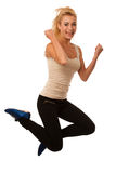 Woman jumps over white background gesturing success Stock Photos