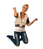 Woman jumps over white background gesturing success Royalty Free Stock Photos