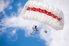 Woman jumps with paraglide. Brasov, Romania - 28 May, 2017: Woman who jumps nicely with paraglide during the demonstration of old planes in Brasov Royalty Free Stock Photos