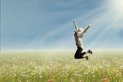 Woman jumps on the park Royalty Free Stock Image