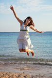 Woman jumps  on  sea  beach Stock Photo