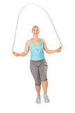 Woman jumps with skipping rope Royalty Free Stock Photo