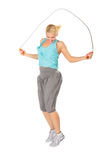 Woman jumps with skipping rope Stock Images