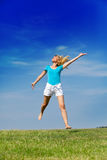 Woman jumps in a summer green field Royalty Free Stock Images