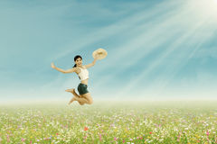 Woman jumps on the summer park Royalty Free Stock Image