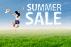 Woman jumps with summer sale cloud Royalty Free Stock Photography