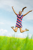 Woman jumps up Royalty Free Stock Image