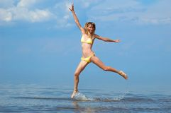 Woman jumps on water Stock Image