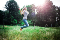 Woman jumps Stock Photo
