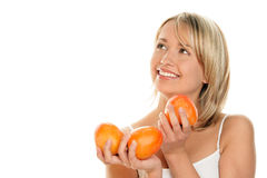 Woman with kaki friuts Stock Images