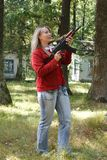 A woman with a Kalashnikov Stock Image