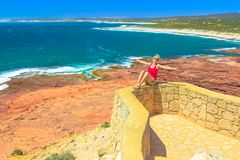 Woman at Kalbarri coral coast. Carefree woman at Red Bluff in Kalbarri National Park. Pederick Lookout overlooking Red Bluff Beach in Australian Coral Coast on royalty free stock images