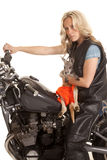 Woman with kangaroo sit on motorcycle looking Royalty Free Stock Photos