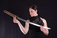 Woman with katana Stock Photo