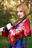 Woman with katana sword Stock Images
