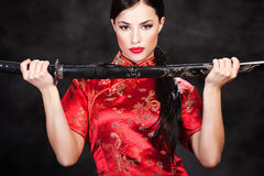 Woman and katana/sword Stock Image