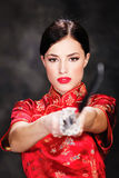Woman and katana / sword Stock Images