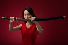 Woman with katana sword Stock Photo