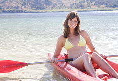 A woman in a kayak stock photos