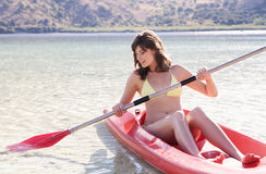 A woman in a kayak Stock Image