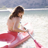 A woman in a kayak stock photo