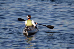 Woman in a kayak Stock Photo