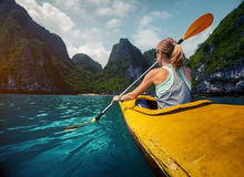 Woman with the kayak Stock Photos