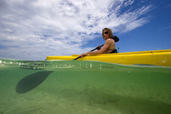 Woman in kayak, Key West, Florida. Over and under of woman in kayak, Key West stock photo