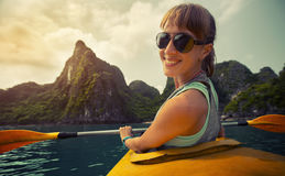 Woman with the kayak stock photography