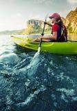 Woman with the kayak Stock Photos