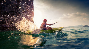 Woman with the kayak Stock Images