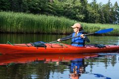 Woman Kayaking Stock Photography