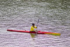 Woman kayaking alone. Kayaker, enjoy. royalty free stock photos