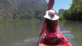 Woman kayaking in beautiful lagoon action camera pov of girl paddling on kayak boat in sea stock footage