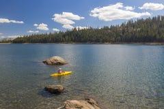 Woman Kayaking on Beautiful Mountain Lake. Stock Photography