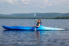 Woman kayaking on a calm lake. Alone stock photography