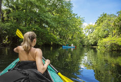 Woman Kayaking down a beautiful tropical jungle river Royalty Free Stock Photography