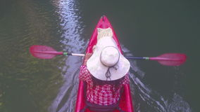 Woman kayaking in lagoon top angle view action camera pov of girl paddling on kayak boat. In sea stock video footage