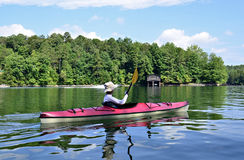 Woman Kayaking on Lake stock photo