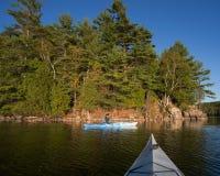 Woman Kayaking on Northern Lake Royalty Free Stock Photos