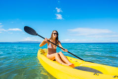 Woman Kayaking in the Ocean on Vacation royalty free stock images