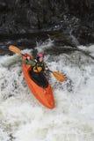 Woman kayaking in river Stock Image