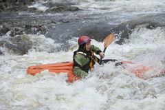 Woman kayaking in river Stock Images