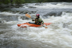 Woman kayaking in river Stock Image