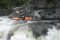 Woman kayaking in river Stock Photos