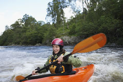 Woman kayaking in river Stock Photography