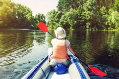 Woman kayaking on river Royalty Free Stock Photos