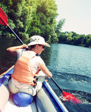 Woman kayaking on river Stock Photo